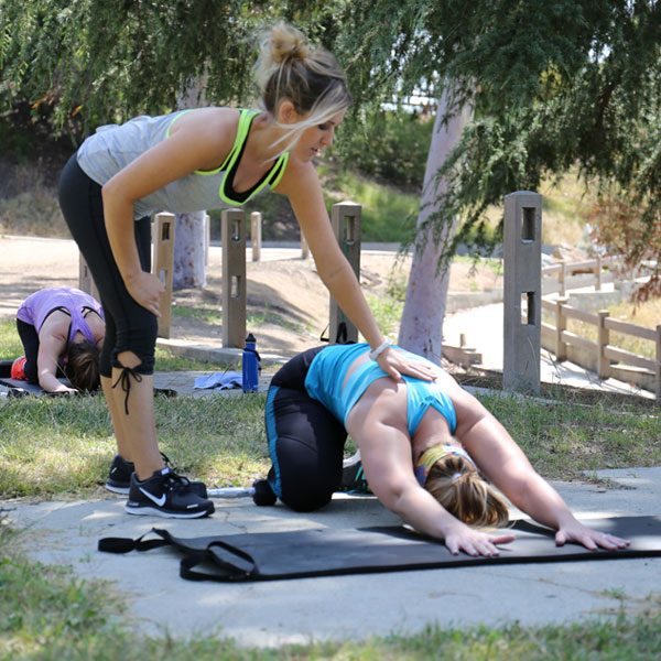 Justine helping client with their yoga for at Eagle Rock Park in Eagle Rock (Los Angeles), CA